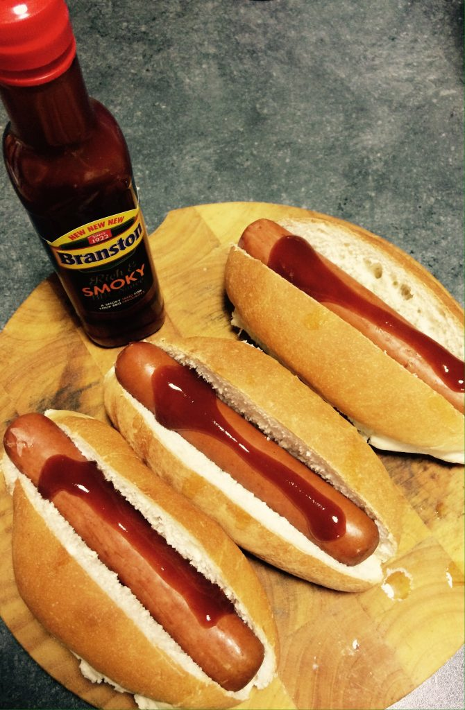 Branston smoky BBQ sauce on hots dogs