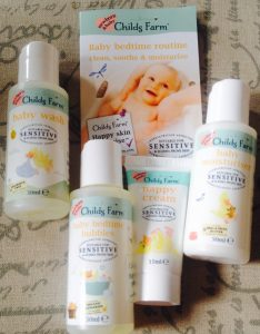 Travel sized bottles of Childs Farm baby kit.