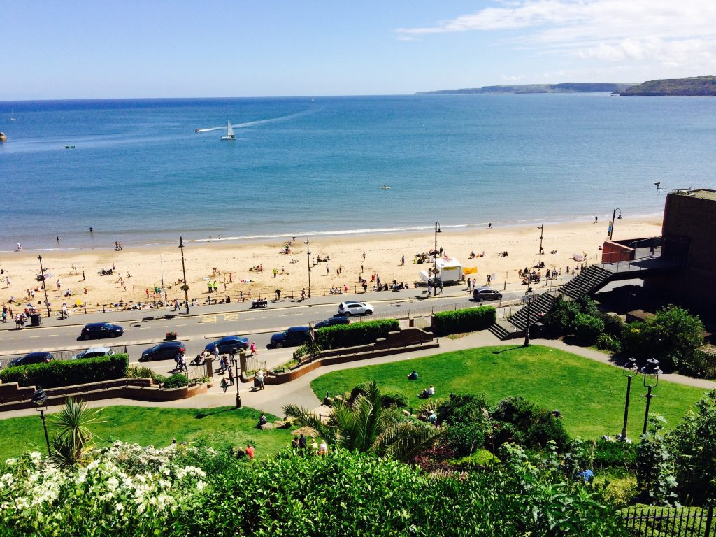 looking down at Scarborough beach from ontop the hill on a sunny day.