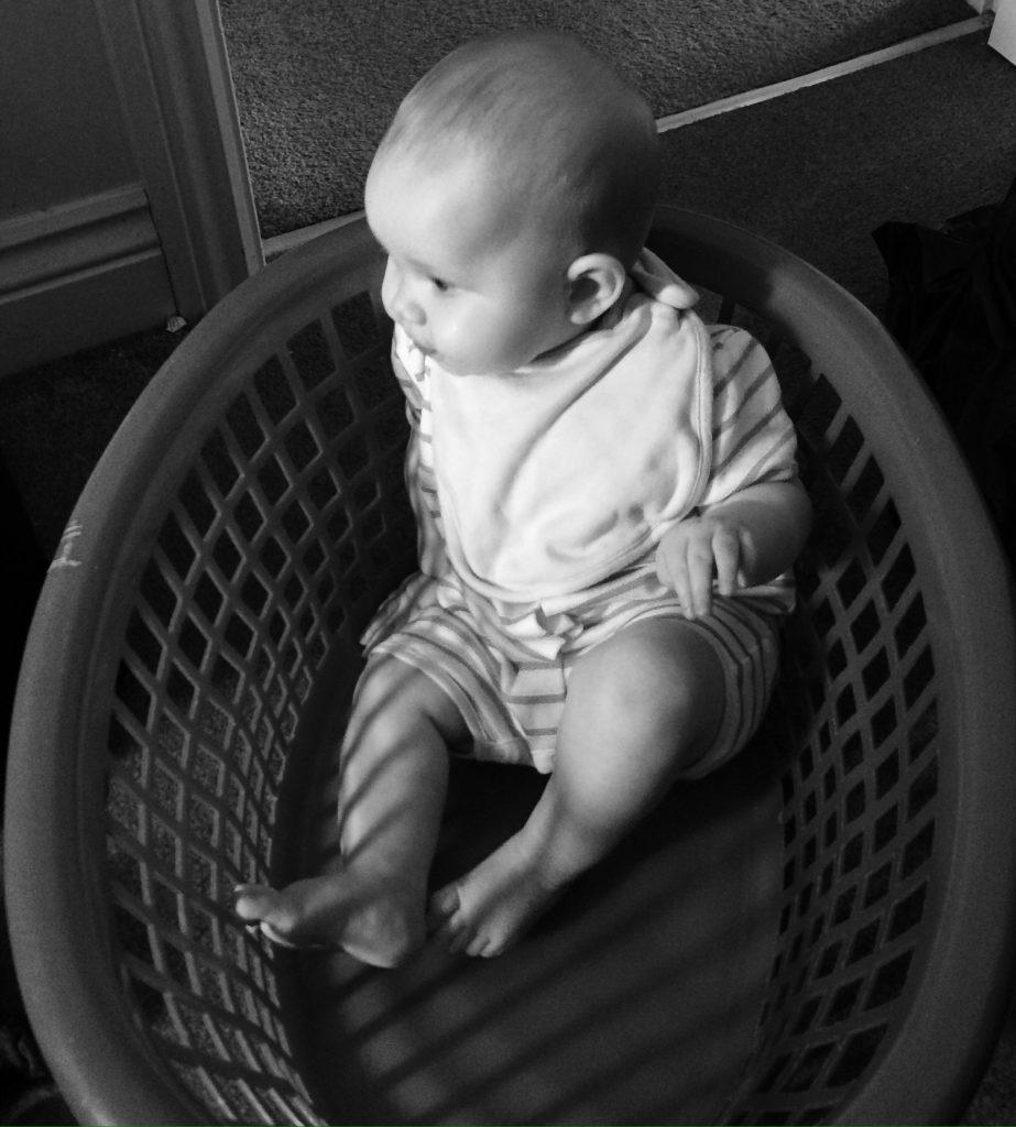baby girl in the washing basket