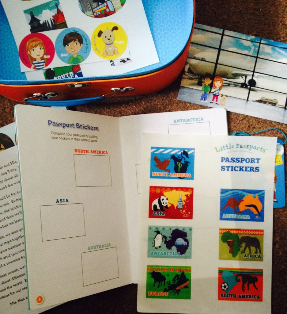 Contents of Little Passports suitcase. Passport with passport stickers