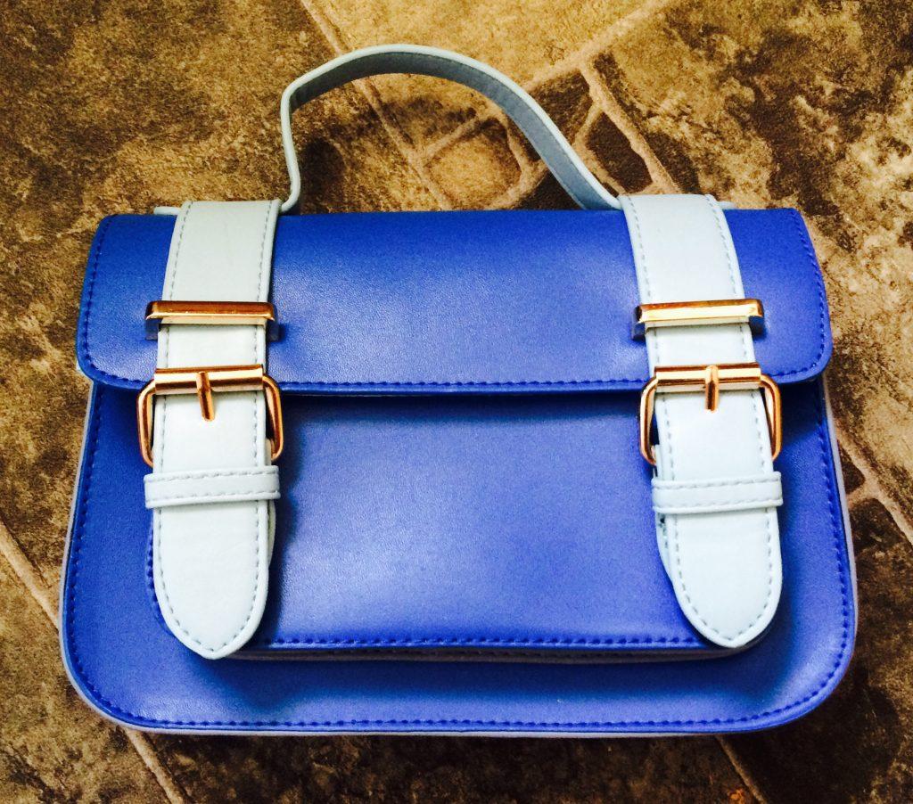 Small blue satchel handbag with shoulder strap