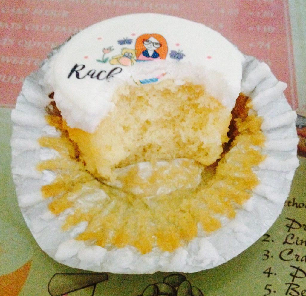 Vanilla sponge cupcake half eaten - Rachel Bustin