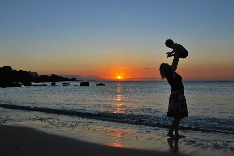new-parent-playing-on-beach