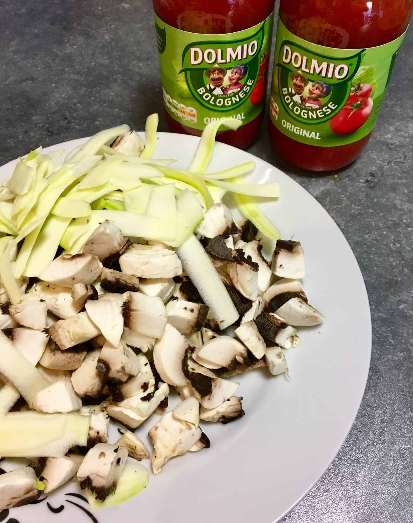 Dolmio Bolognese sauce with a plate of mushroom and courgette