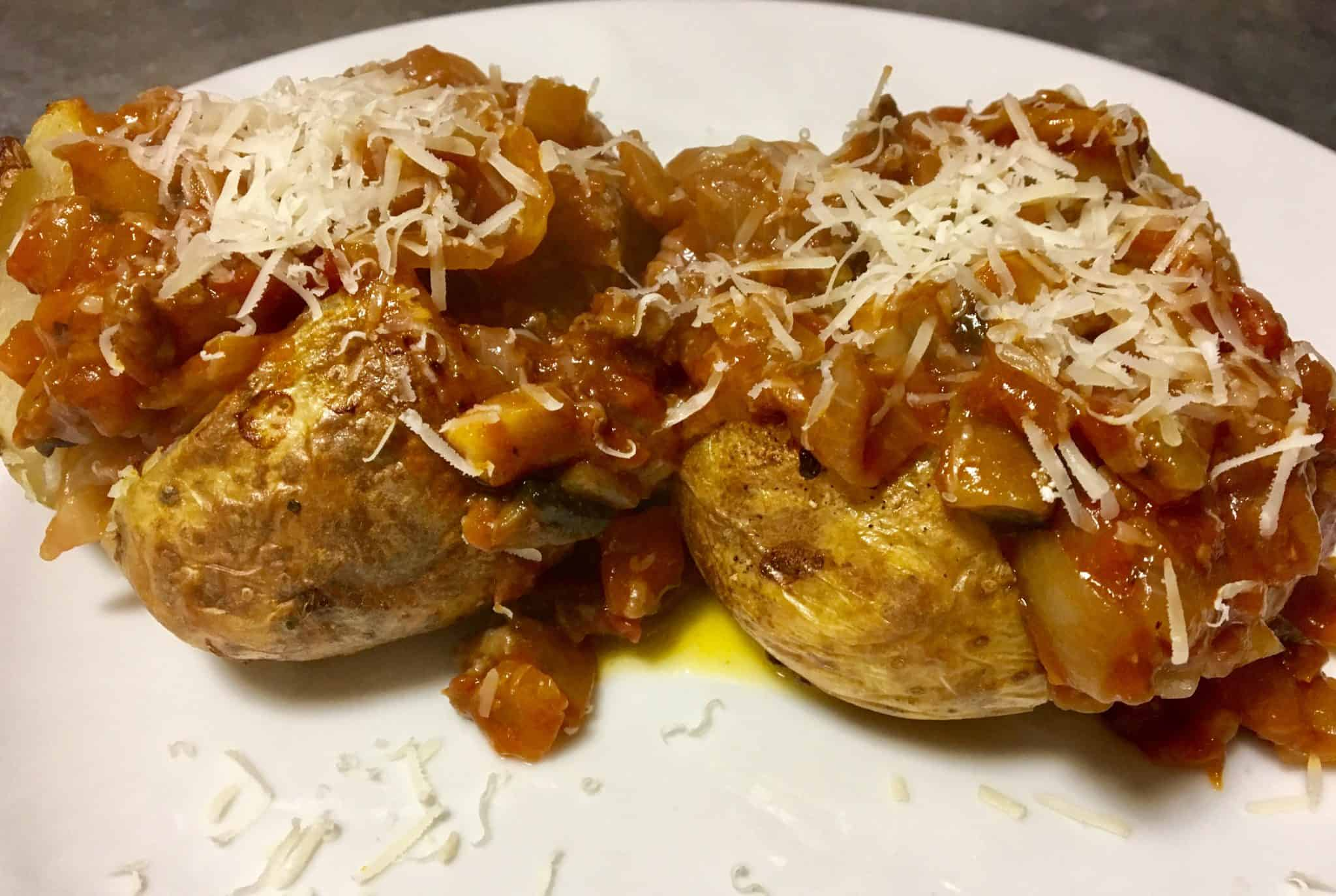 Jacket Potatoes with bolognese and grated parmasan