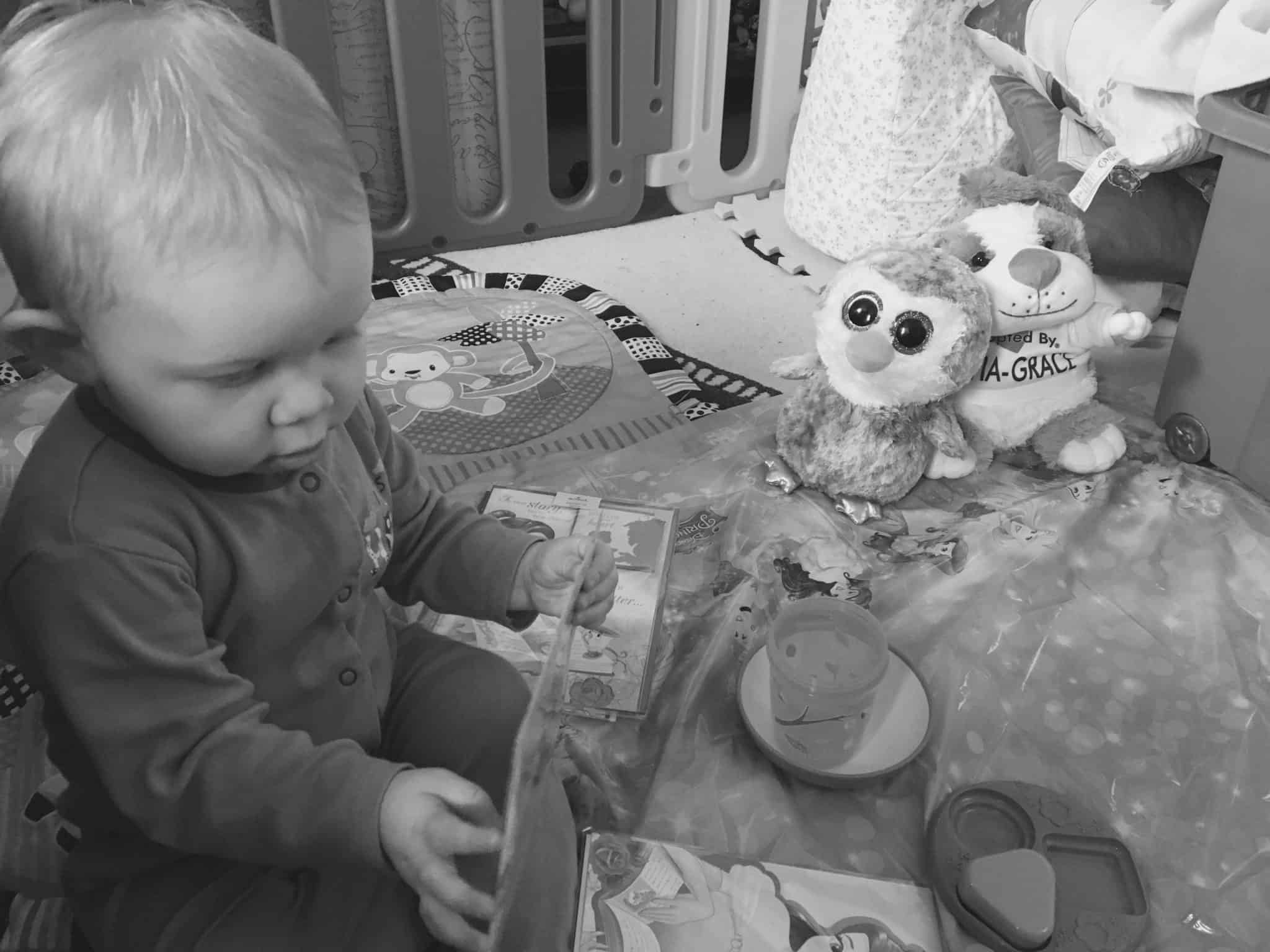 Baby girl enjoying her Beauty and the Beast tea party
