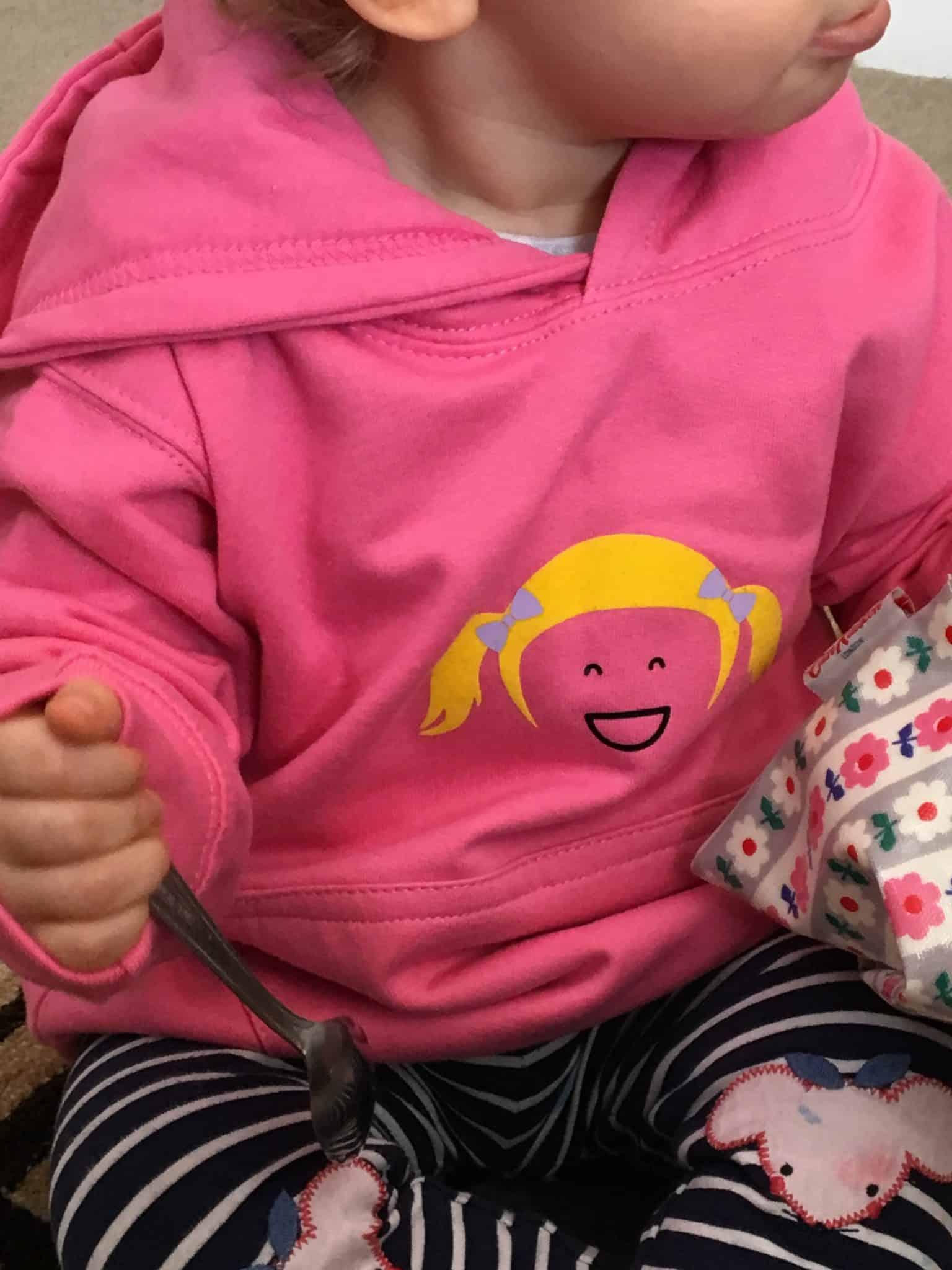 baby girl wearing pink love millie hoody
