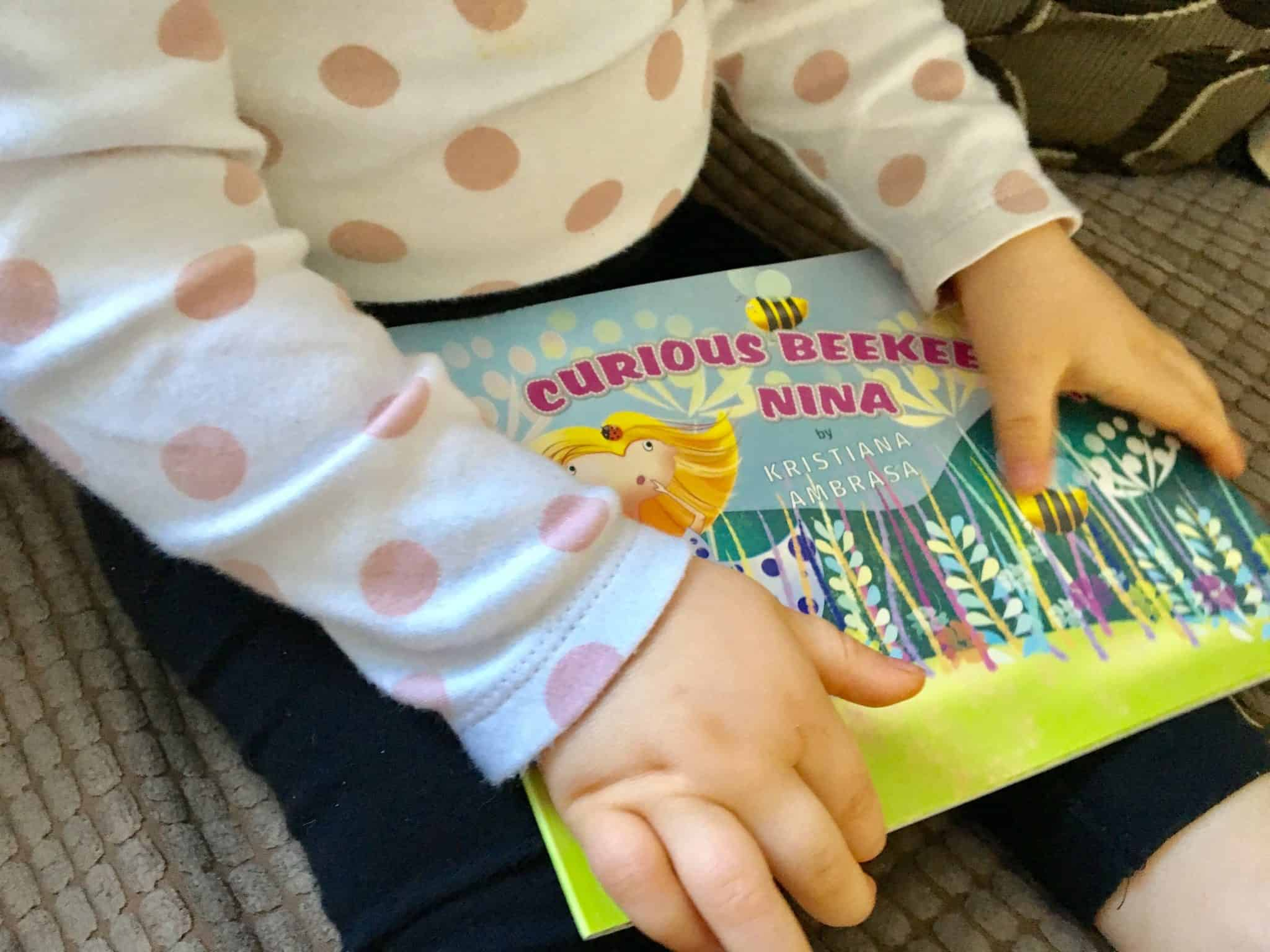 Baby Girl with her new book