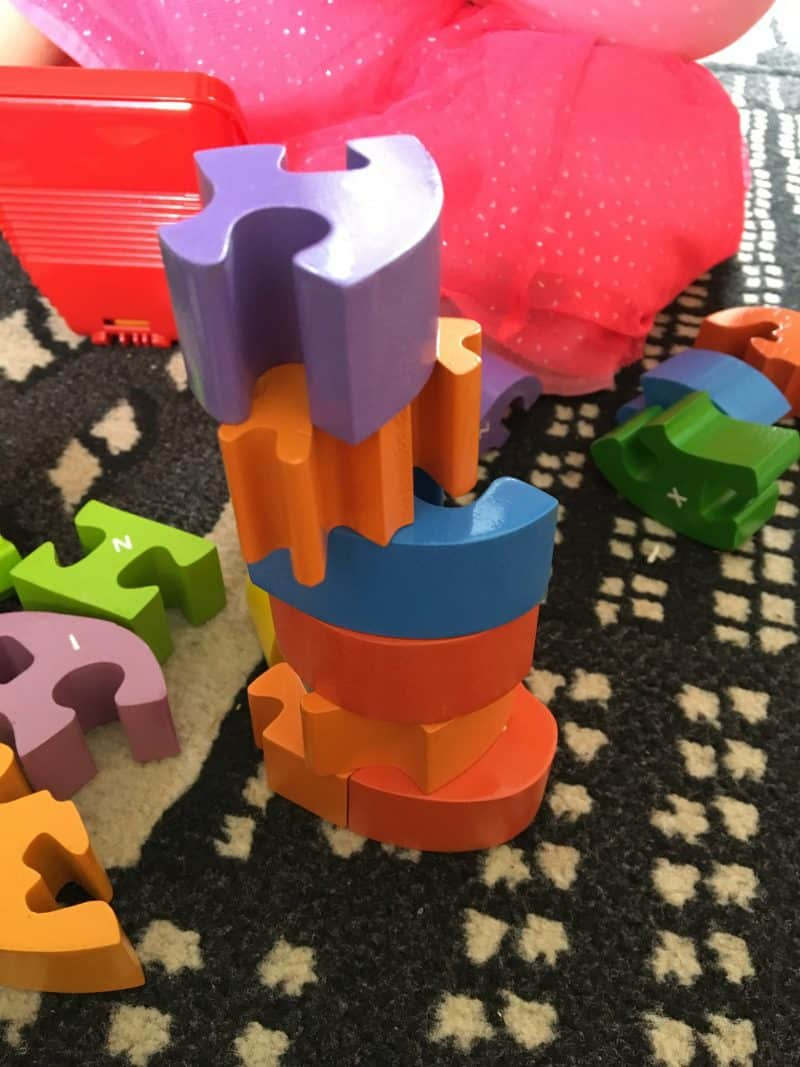 stacking wooden pieces for the wooden alphabet snake