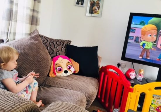 Baby girl watching PJ Masks: Time to be a Hero