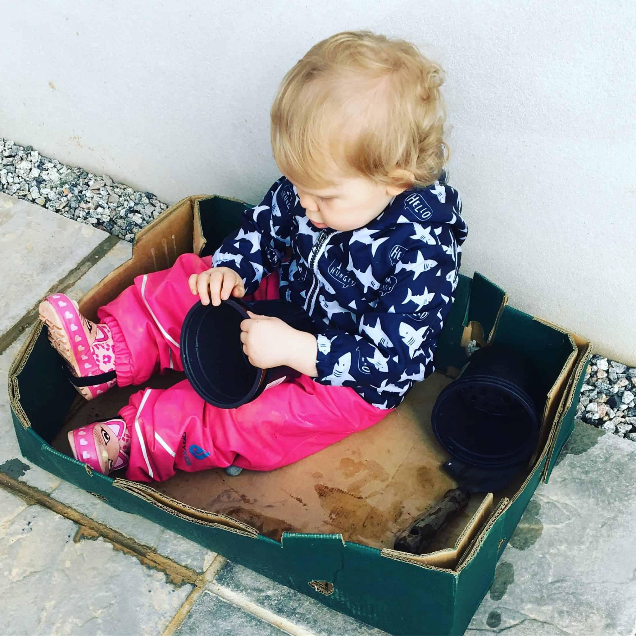 Baby girl playing outside