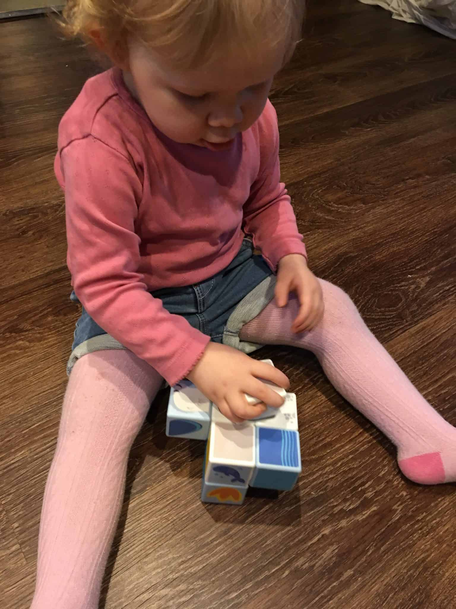 baby girl playing with the magicube polar animals
