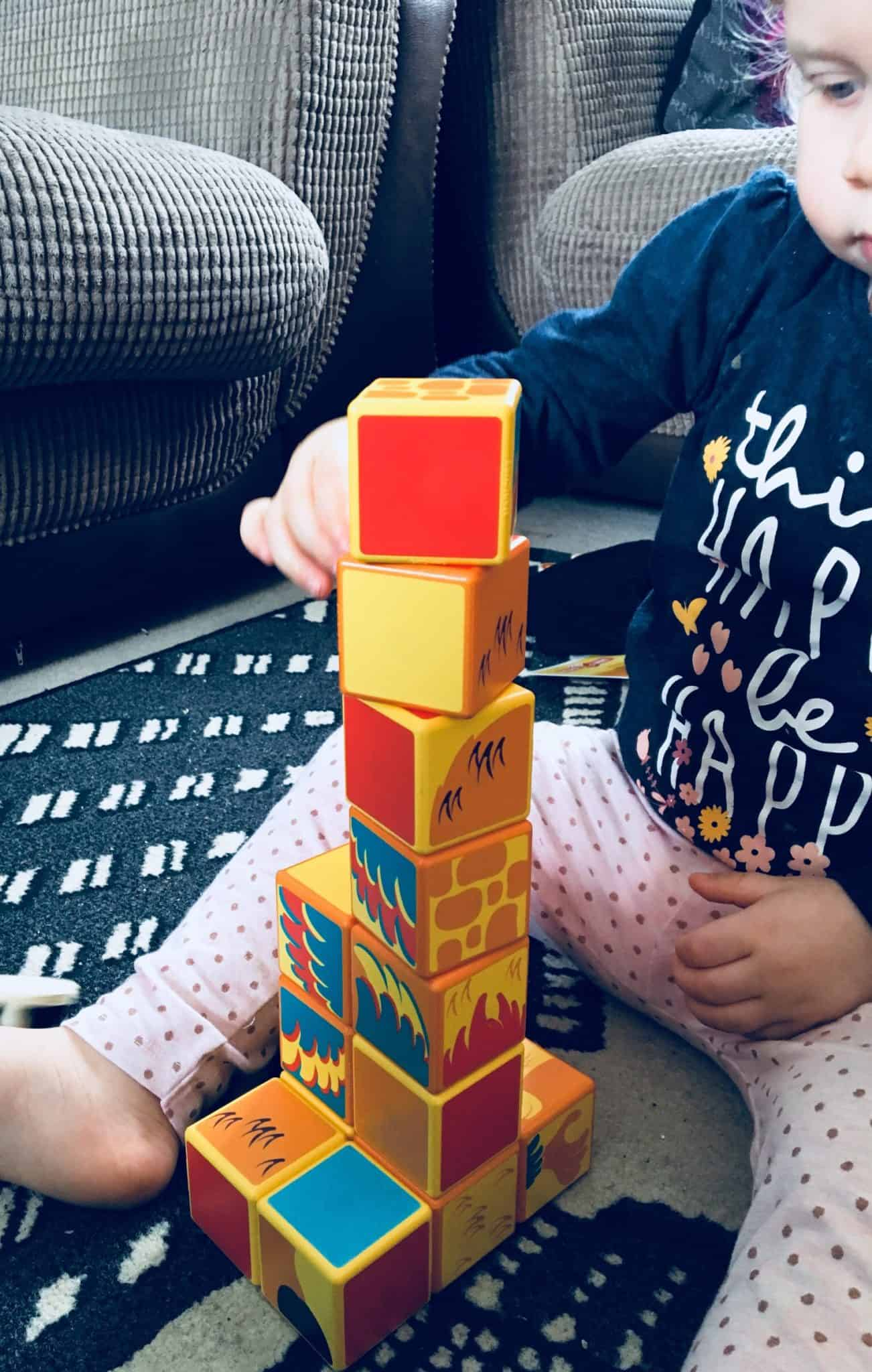 baby girl building her magicube's