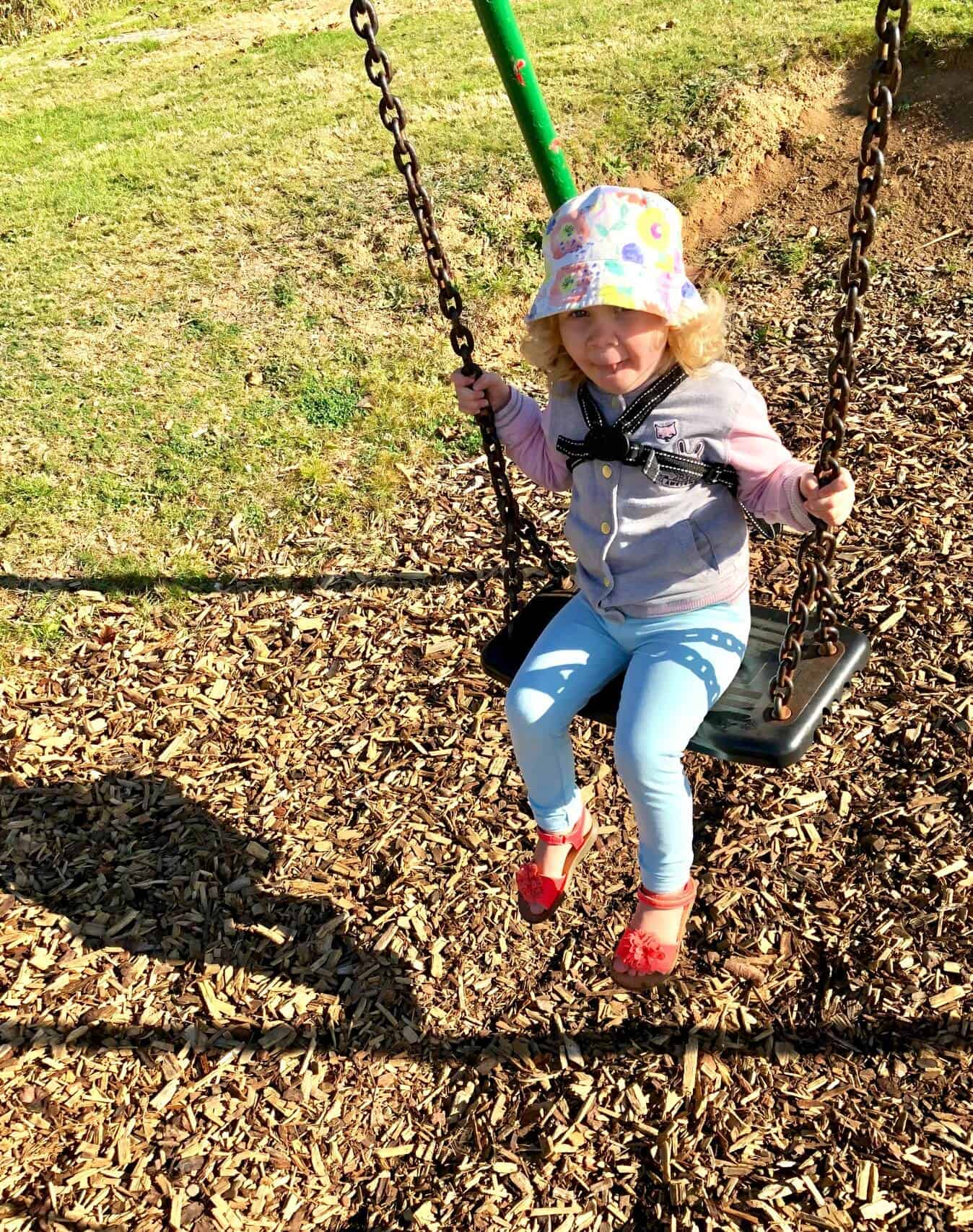 toddler on the swings