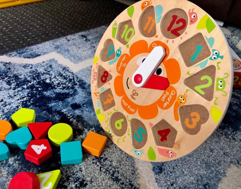 Hape's Kitchen and Food range - wooden clock puzzle