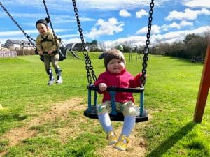 5 Outdoor Activities for Toddlers and Preschoolers on the swings at the park