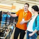 TV Shopping: Important Considerations to Choose the Right TV - lady in a TV shop choosing a TV