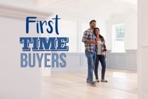 young couple who are first time buyers moving into their new home