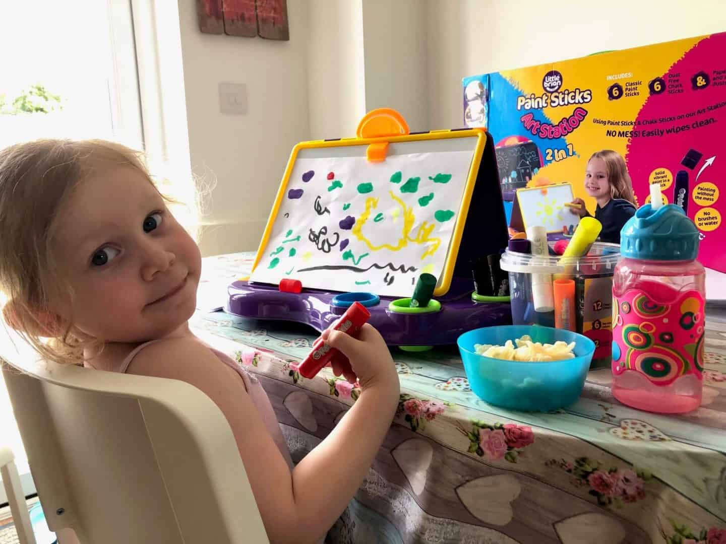 L with her paint station and paint sticks