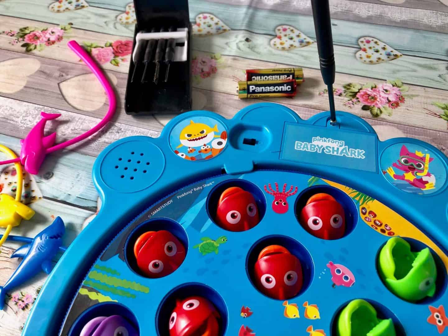 putting-the-batteries-in-Baby-Shark-Lets-Go-Hunt