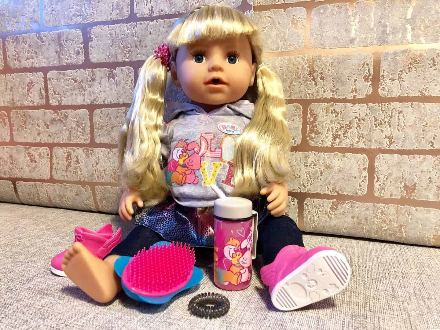 Baby-Born-Soft-Touch-Sister-with-hairbrush-and-beaker
