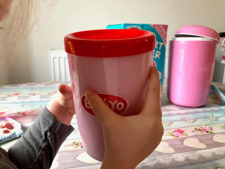 Shaking the yogurt mix in the jar