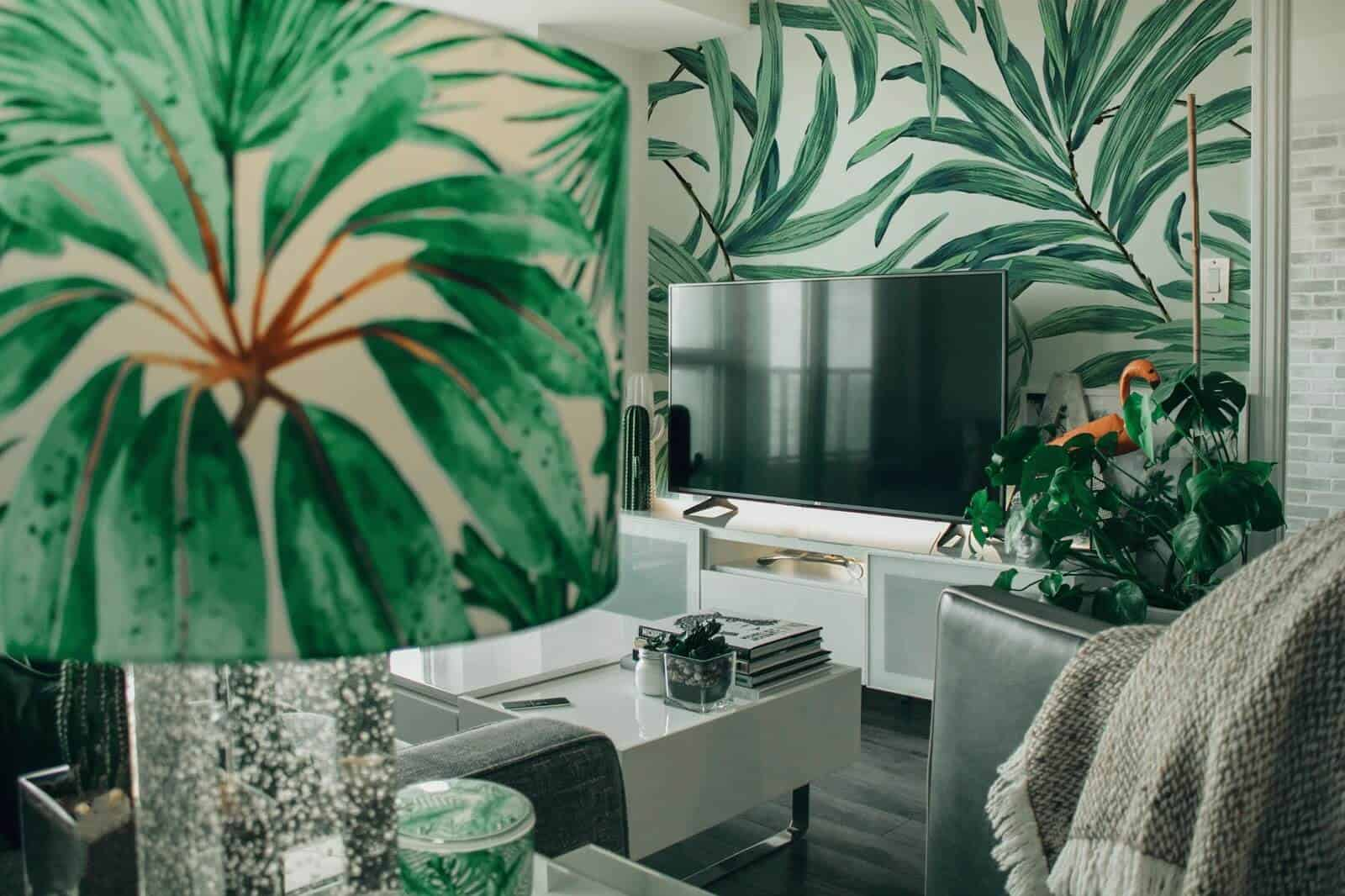 Living room interior with leaf print wallpaper