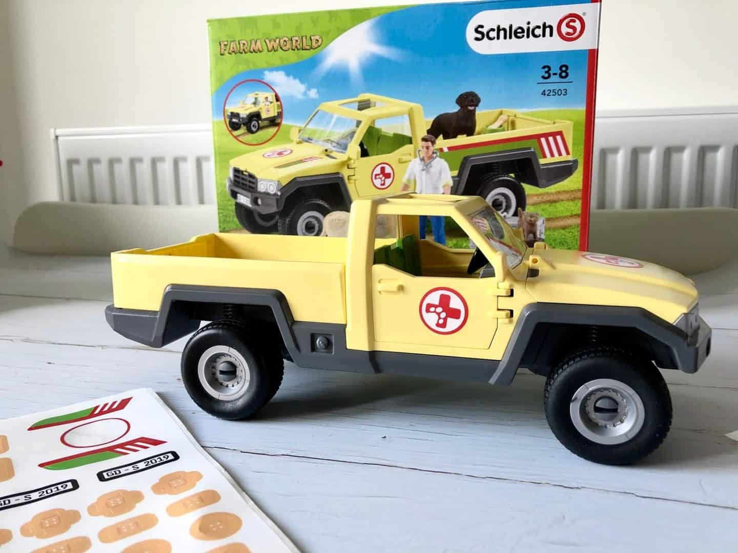 Putting the stickers in the Schleich Farm World  Veterinarian Visit at the Farm Pickup