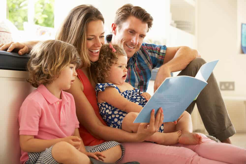Parents Sitting With Children Reading Story - ways to make the most of your time at home