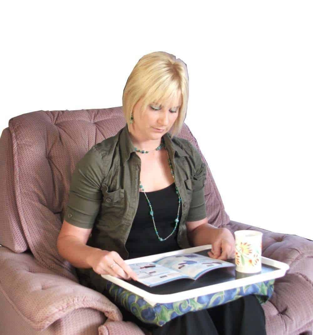 Lady using a laptop tray - daily aids for the elderly or limited mobility
