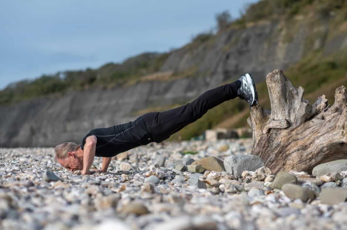 Stu doing press ups on the pebble beach