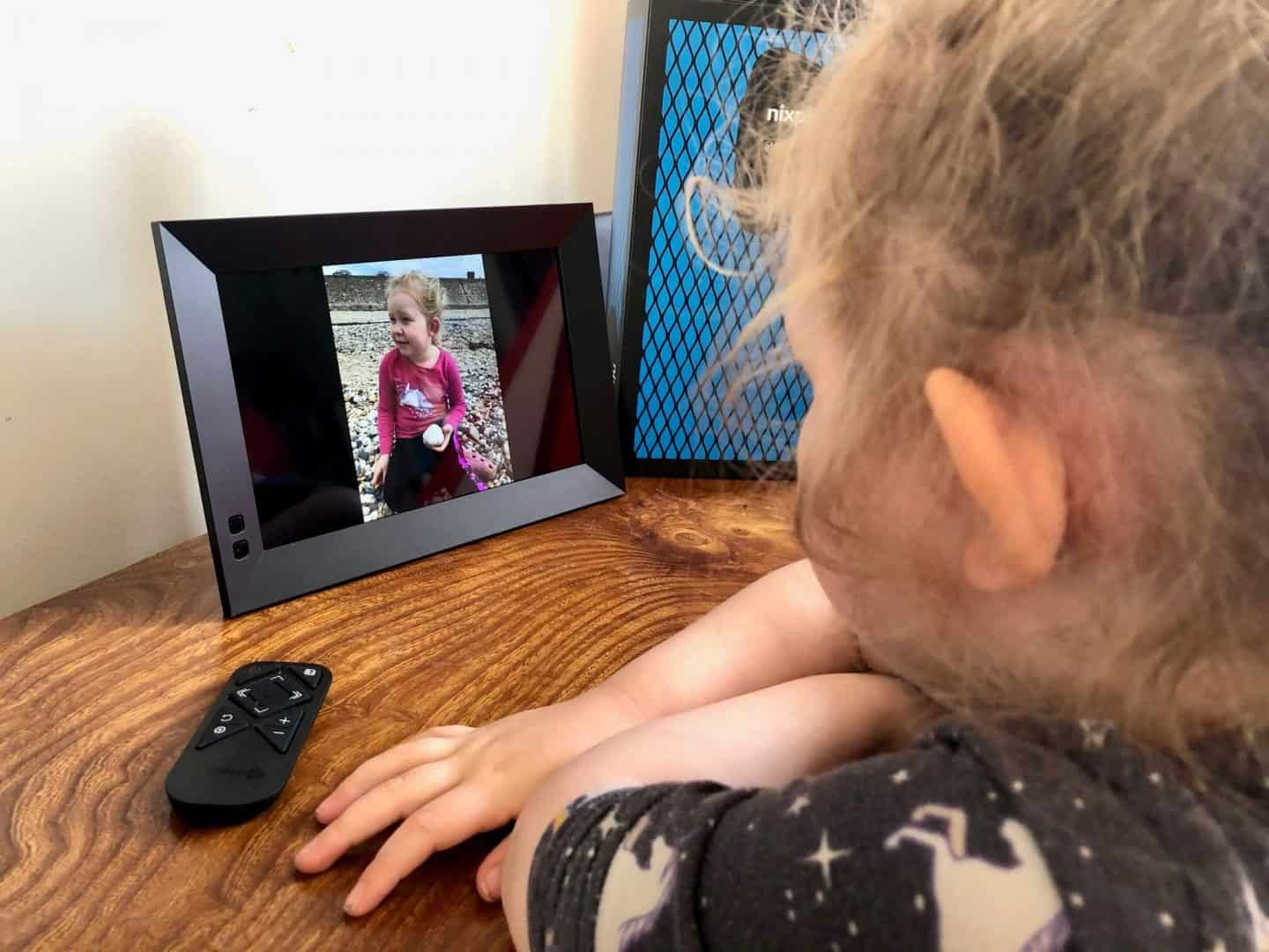 L watching herself on the Nixplay smart photo frame