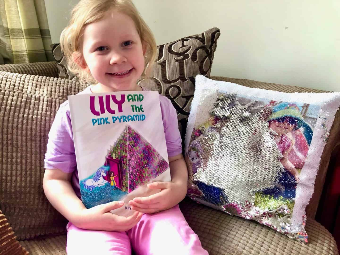 L with her book - Lily and the Pink Pyramid