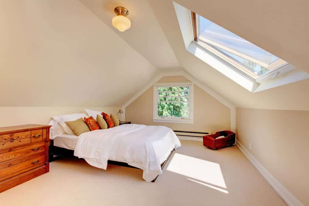 Converting a Loft Space Into an Extra Bedroom - modern attic bedroom