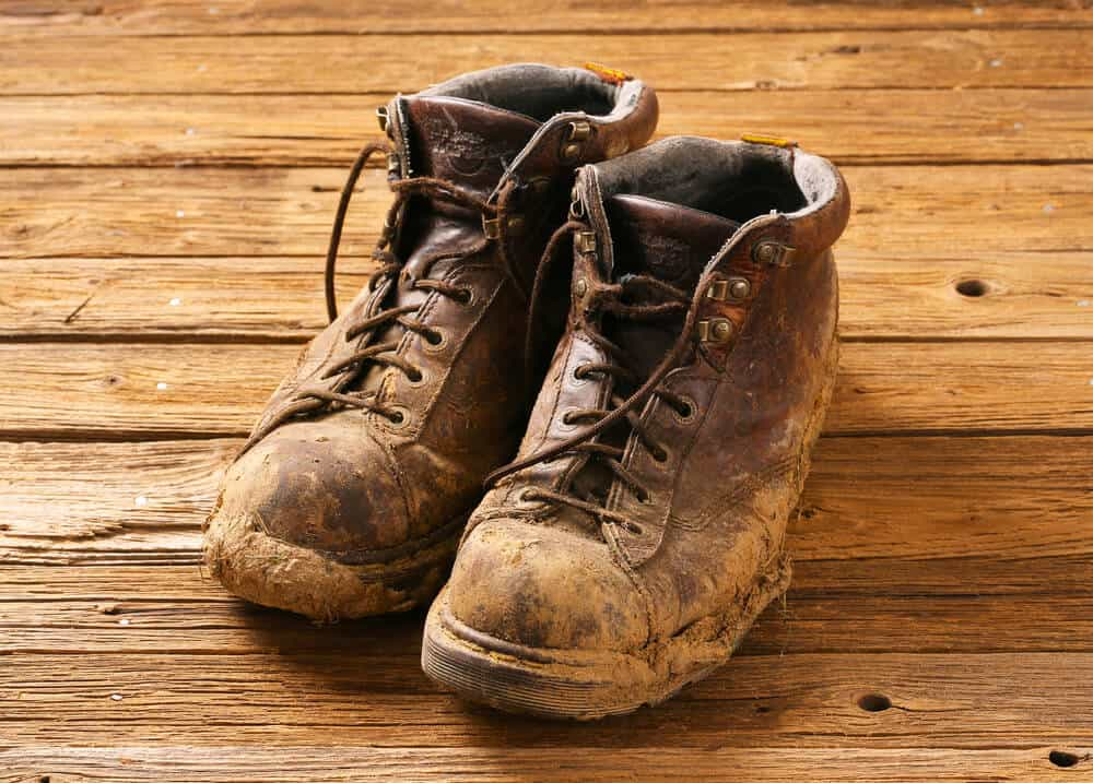 muddy shoes on wood floor