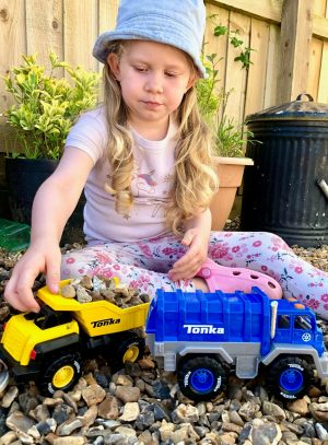 L playing with the Tonka Trucks