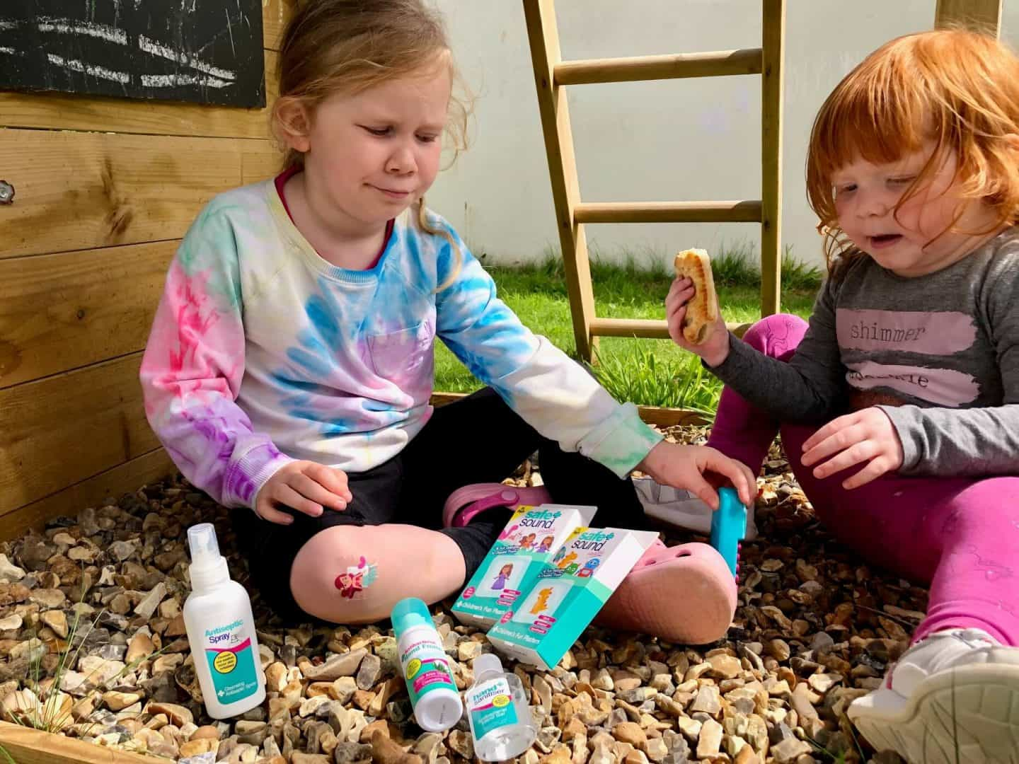 L with a plaster on her knee - Top Tips Packing a First Aid Kit For Outdoor Adventures With The Kids