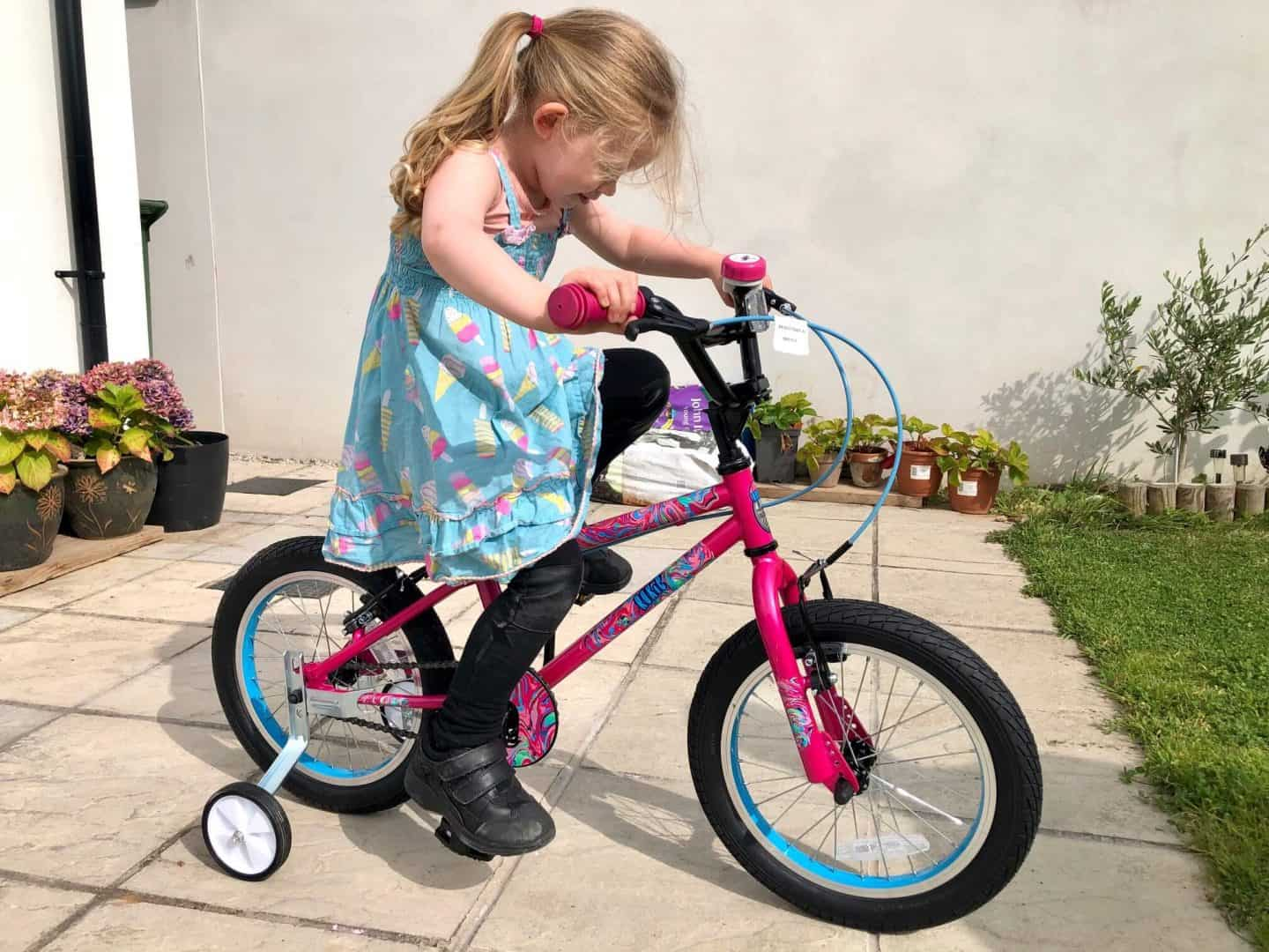 L on her new bike August 2020