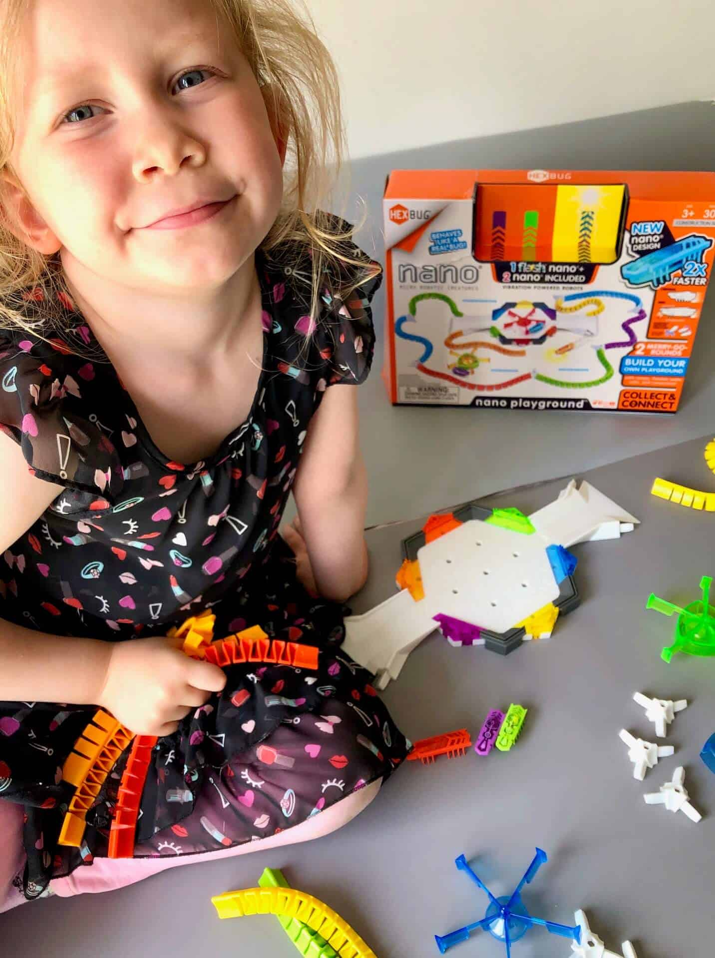 L with her HEXBUG nano Flash Playground Set