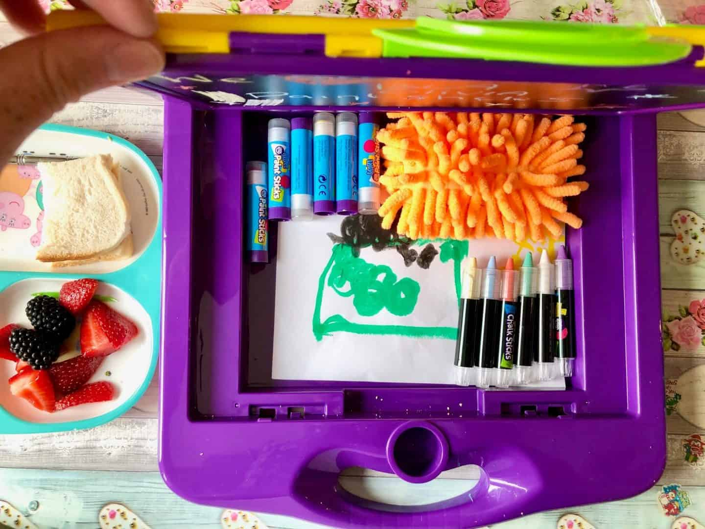 Storage compartment in the Little Brian Paint Sticks Mini Art Station