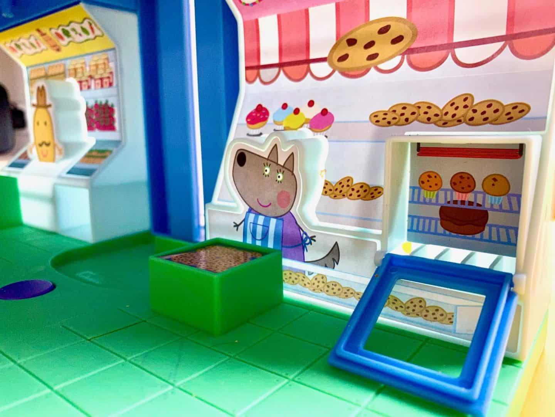 open the oven door on the peppa pig shop playset