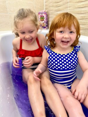 Playing in the Glitter slime baff