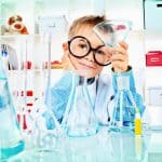 3 Signs Your Child is Attending a Good School - child doing science experience